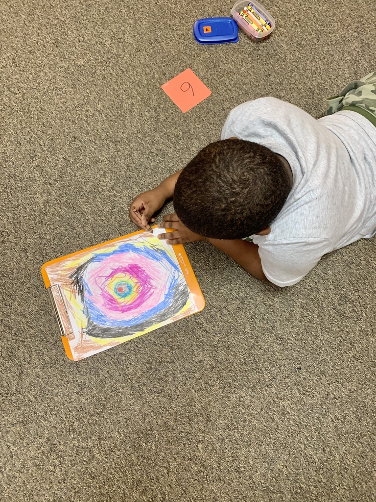 Mrs. Denmon's class creating their Kandinsky-inspired masterpieces