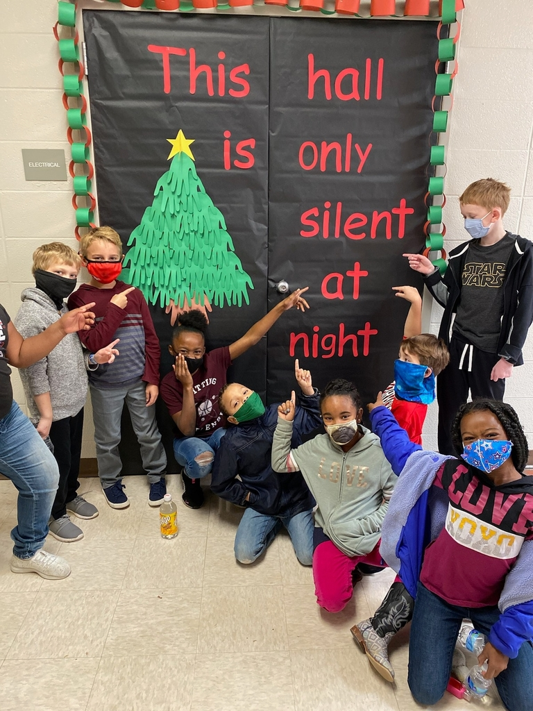 Students Pointing at Christmas Sign