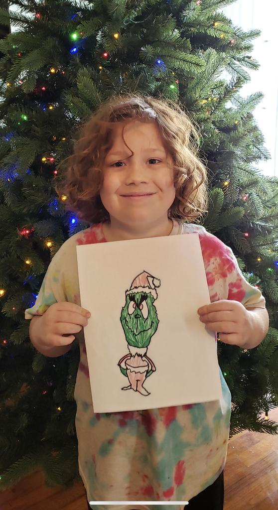 Rohan holding his Grinch drawing
