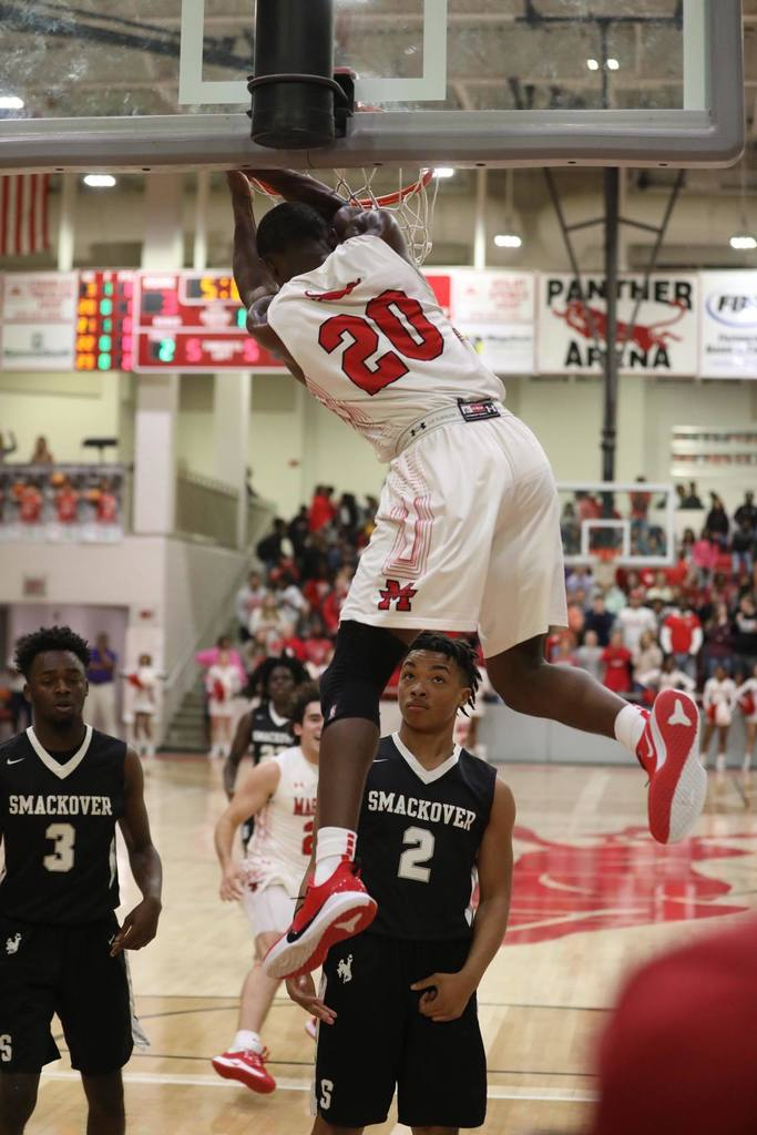 Sophomore Derrian Ford dunks against Smackover at Panther Arena