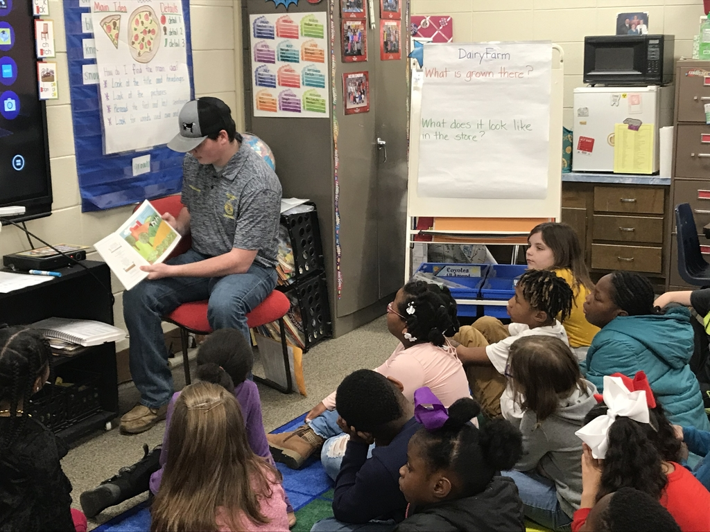 FFA member Zane McWilliams reading to 2nd grade Superheroes!