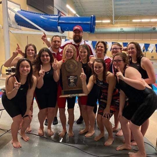 Swimmers posing with trophy