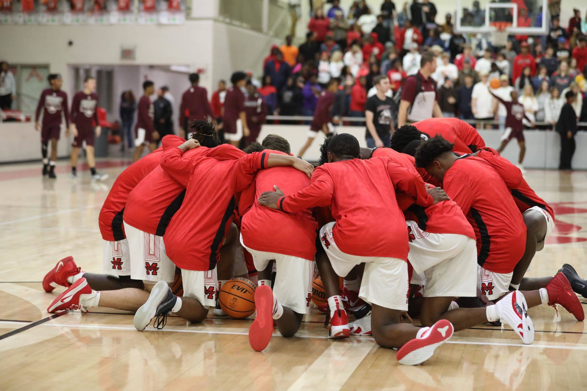 Basketball team huddled before a game.